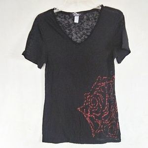 Dali museum tee with rose graphic.